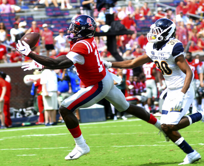FILE - In this Sept. 22, 2018, file photo, Mississippi wide receiver D.K. Metcalf (14) makes a touchdown catch ahead of Kent State cornerback Darryl Marshall (30) in the third quarter of an NCAA college football game at Vaught-Hemingway Stadium in Oxford, Miss. Metcalf is a possible pick in the 2019 NFL Draft. (Bruce Newman/The Oxford Eagle via AP)
