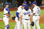 Los Angeles Dodgers starting pitcher Tony Gonsolin leaves the game during the fifth inning in Game 2 of a baseball National League Championship Series against the Atlanta Braves Tuesday, Oct. 13, 2020, in Arlington, Texas. (AP Photo/Eric Gay)