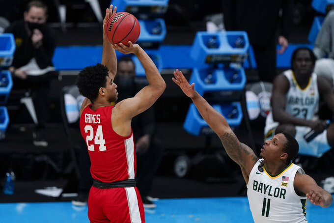 Houston guard Quentin Grimes (24) shoots on Baylor guard Mark Vital (11) during the first half of a men's Final Four NCAA college basketball tournament semifinal game, Saturday, April 3, 2021, at Lucas Oil Stadium in Indianapolis. (AP Photo/Michael Conroy)
