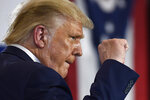 President Donald Trump pumps his fist as he finishes speaking during an event at the Whirlpool Corporation facility in Clyde, Ohio, Thursday, Aug. 6, 2020.  (AP Photo/Susan Walsh)