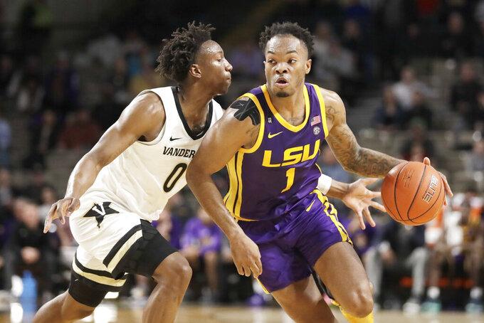 LSU guard Javonte Smart (1) drives against Vanderbilt's Saben Lee (0) in the first half of an NCAA college basketball game Wednesday, Feb. 5, 2020, in Nashville, Tenn. (AP Photo/Mark Humphrey)