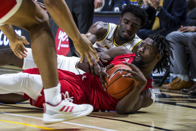 Virginia Commonwealth guard Vince Williams (10) and Jacksonville State point guard Ty Hudson (4) fight for the ball during the second half of an NCAA college basketball game Sunday, Nov. 17, 2019, in Richmond, Va. (AP Photo/Zach Gibson)