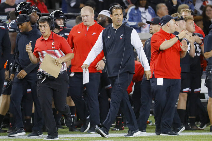 Cincinnati coach Luke Fickell walks along the sideline during the first half of the team's NCAA college football game against UCF, Friday, Oct. 4, 2019, in Cincinnati. (AP Photo/John Minchillo)