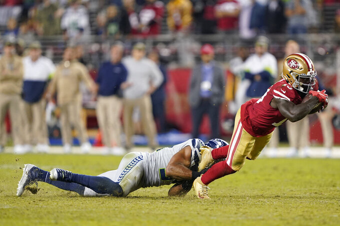 San Francisco 49ers wide receiver Deebo Samuel, right, is tackled by Seattle Seahawks middle linebacker Bobby Wagner during the second half of an NFL football game in Santa Clara, Calif., Monday, Nov. 11, 2019. (AP Photo/Tony Avelar)