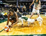 Chicago Sky center Astou Ndour-Fall, front top, battles Seattle Storm guard Jordin Canada for the ball in the first quarter of a WNBA basketball game Friday, Aug. 27, 2021, in Everett, Wash. (Dean Rutz/The Seattle Times via AP)