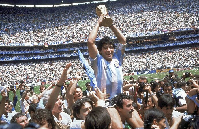 FILE - In this June 29, 1986 file photo, Diego Maradona holds up his team's trophy after Argentina's 3-2 victory over West Germany at the World Cup final soccer match at Azteca Stadium in Mexico City. The Argentine soccer great who was among the best players ever and who led his country to the 1986 World Cup title before later struggling with cocaine use and obesity, died from a heart attack on Wednesday, Nov. 25, 2020, at his home in Buenos Aires. He was 60. (AP Photo/Carlo Fumagalli, File)