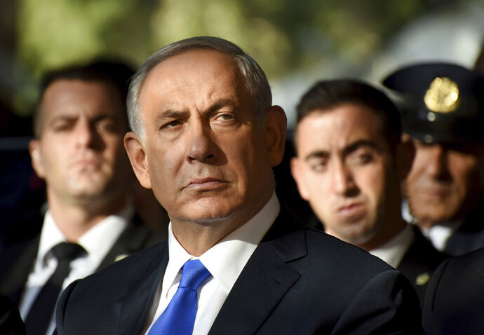 FILE - In this file photo taken on Oct. 26, 2015, Israeli Prime Minister Benjamin Netanyahu attends the official memorial ceremony marking the 20th anniversary of the assassination of the late Prime Minister Yitzhak Rabin in the Mt. Herzl Cemetery in Jerusalem. (Debbie Hill/Pool Photo via AP, File)
