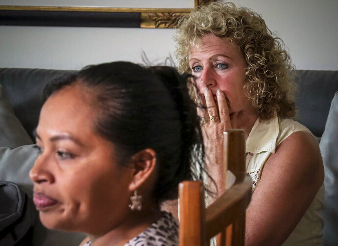 In this Wednesday, Aug. 21, 2019 photo, Vivien Tartter, right, listens as Guatemalan immigrant Rosayra Pablo Cruz speaks during an interview, in New York. Tartter opened the doors of her Manhattan apartment to Cruz and her sons who had been separated at a detention center in Colorado, reunited in New York and had no place to stay.