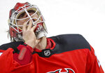 New Jersey Devils goaltender Mackenzie Blackwood (29) pulls off his mask during a timeout during the first period of an NHL game against the Washington Capitals Sunday, Feb. 28, 2021, in Newark, N.J. (Andrew Mills/NJ Advance Media via AP)