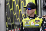 FILE- In this Friday, Jan. 3, 2020, file photo, Kyle Busch heads to his garage during testing for the upcoming Rolex 24 hour auto race at Daytona International Speedway in Daytona Beach, Fla. Although his bid for a third championship doesn't begin until the Daytona 500 on Feb. 16, Busch's racing season starts this weekend with a cameo appearance in the Rolex 24 at Daytona. (AP Photo/John Raoux, File)