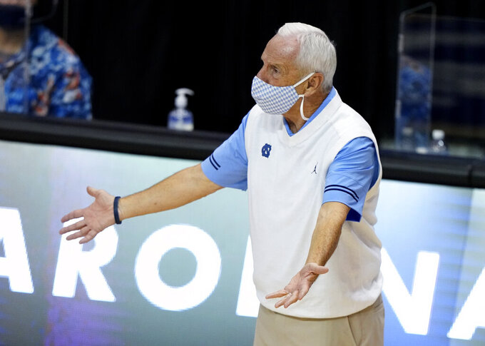 North Carolina head coach Roy Williams reacts to his team in the second half of an NCAA college basketball game for the championship of the Maui Invitational, Wednesday, Dec. 2, 2020, in Asheville, N.C. Texas won 69-67. (AP Photo/Kathy Kmonicek)