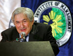 FILE - In this March 5, 2008, file photo, former World Bank President James Wolfensohn delivers his message during a dialogue dubbed