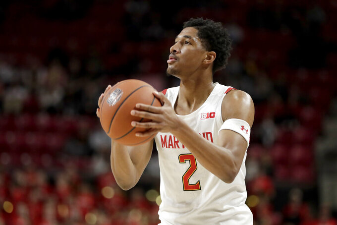 Maryland guard Aaron Wiggins shoots against George Mason during the second half of an NCAA college basketball game Friday, Nov. 22, 2019, in College Park, Md. Maryland won 86-63. (AP Photo/Julio Cortez)