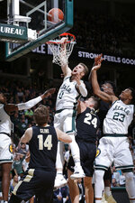 Michigan State's Kyle Ahrens, top, Aaron Henry, left, and Xavier Tillman (23) and Purdue's Ryan Cline (14), Grady Eifert (24) and Trevion Williams vie for a rebound during the second half of an NCAA college basketball game, Tuesday, Jan. 8, 2019, in East Lansing, Mich. Michigan State won 77-59. (AP Photo/Al Goldis)