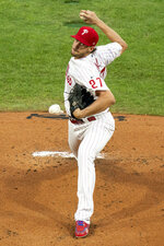 Philadelphia Phillies starting pitcher Aaron Nola throws during the first inning of a baseball game against the Miami Marlins, Friday, July 24, 2020, in Philadelphia. (AP Photo/Chris Szagola)