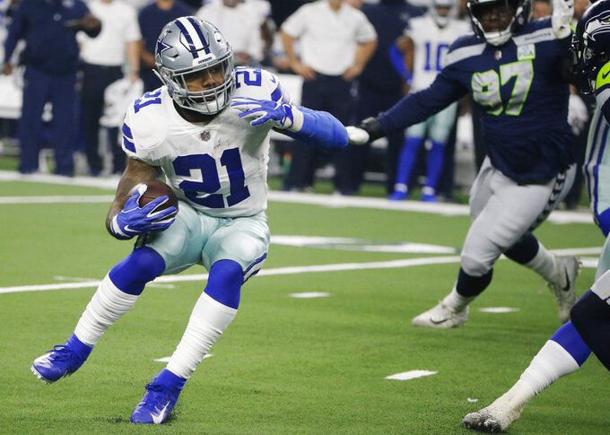 Dallas Cowboys running back Ezekiel Elliott (21) runs against the Seattle Seahawks during the first half of the NFC wild-card NFL football game in Arlington, Texas, Saturday, Jan. 5, 2019. (AP Photo/Michael Ainsworth)