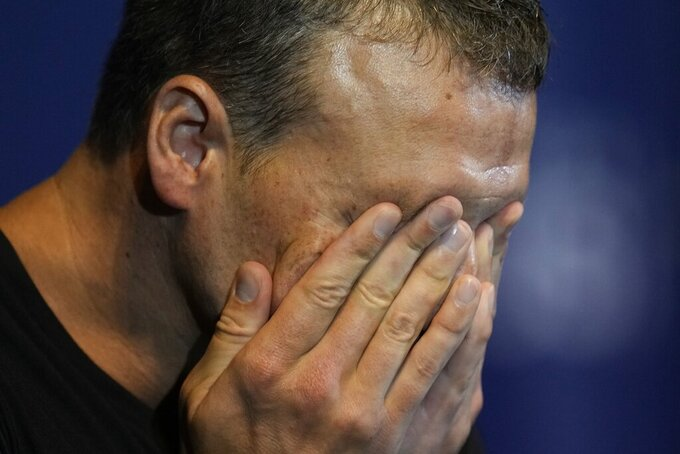 Ryan Lochte crys during an interview after the men's 200 individual medley during wave 2 of the U.S. Olympic Swim Trials on Friday, June 18, 2021, in Omaha, Neb. (AP Photo/Jeff Roberson)