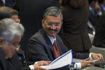 India's joint secretary of the Foreign Ministry, Deepak Mittal, talks to his delegation members prior to presenting oral arguments at the International Court of Justice, or World Court, in The Hague, Netherlands, Monday, Feb. 18, 2019. India is taking Pakistan to the United Nations' highest court in an attempt to save the life of an Indian naval officer sentenced to death last month by a Pakistani military court after being convicted of espionage.(AP Photo/Peter Dejong)