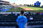 Fans watch batting practice before a baseball game between the Toronto Blue Jays and the Miami Marlins in Buffalo, N.Y., Tuesday, June 1, 2021. (AP Photo/Adrian Kraus)