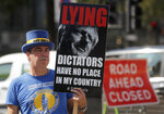 A pro EU protester stands near Parliament in London, Monday, Sept. 14, 2020. Boris Johnson is facing the possibility of a Tory rebellion and major damage to his chances of a trade deal with the EU unless he removes controversial parts of the internal Bill which is in the House of Commons for its second reading Monday.(AP Photo/Frank Augstein)