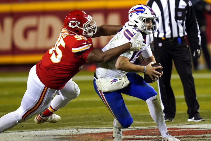 Kansas City Chiefs defensive tackle Chris Jones, left, tackles Buffalo Bills quarterback Josh Allen during the second half of the AFC championship NFL football game, Sunday, Jan. 24, 2021, in Kansas City, Mo. (AP Photo/Orlin Wagner)