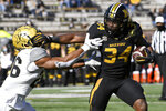 Missouri running back Larry Rountree III (34) runs for a touchdown past Vanderbilt linebacker Anfernee Orji during the first half of an NCAA college football game Saturday, Nov. 28, 2020, in Columbia, Mo. (AP Photo/L.G. Patterson)