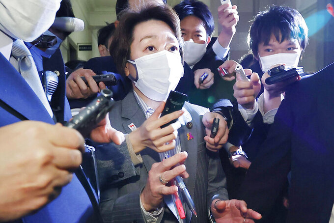 "Japan's Olympics Minister Seiko Hashimoto, center, is surrounded by reporters at the Lower House in Tokyo, Wednesday, Feb. 17, 2021. Japan's Kyodo news agency, citing a source ""familiar with the matter,"" said Wednesday, a selection committee will ask Hashimoto to become the new president of the Tokyo Olympic organizing committee. Hashimoto, who could be named this week, would replace Yoshiro Mori who was forced to resign last week after he made demeaning comments about women — basically saying they talk too much.(Meika Fujio/Kyodo News via AP)"