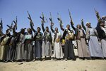 FILE - In this Saturday Sept. 21, 2019 file photo, Shiite Houthi tribesmen hold their weapons as they chant slogans during a tribal gathering showing support for the Houthi movement, in Sanaa, Yemen. On Wednesday, April 8, 2020, the Saudi-led coalition fighting the Iranian-backed Houthi rebels in Yemen announced that its forces would begin a cease-fire starting at midnight, in what could pave the way for the first direct peace talks between the two sides that have been at war for more than five years. (AP Photo/Hani Mohammed)