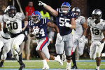 Mississippi offensive lineman Ben Brown (55) gestures as Mississippi running back Snoop Conner (24) heads for an 84-yard touchdown run against Vanderbilt during the second half of an NCAA college football game in Oxford, Miss., Saturday, Oct. 5, 2019. Mississippi won 31-6. (AP Photo/Rogelio V. Solis)