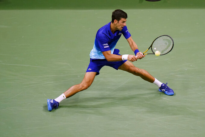 Novak Djokovic, of Serbia, returns a shot to during the first round of the US Open tennis championships, Tuesday, Aug. 31, 2021, in New York. (AP Photo/Frank Franklin II)