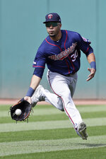 Minnesota Twins' LaMonte Wade Jr. fields a single hit by Cleveland Indians' Roberto Perez in the fifth inning in the first baseball game of a baseball doubleheader, Saturday, Sept. 14, 2019, in Cleveland. (AP Photo/Tony Dejak)