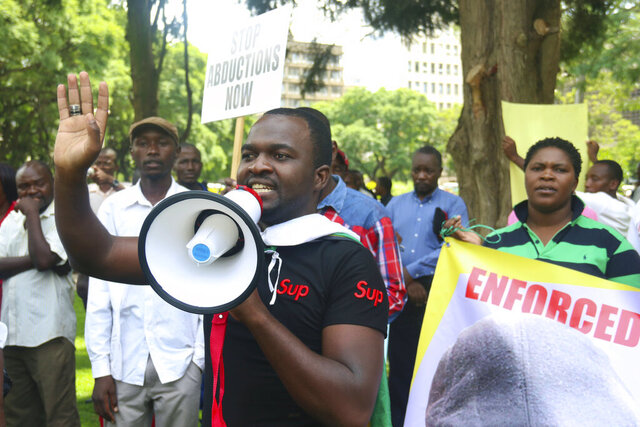 Patson Dzamara addresses people during a protest in Harare, Zimbabwe in this Tuesday, March,8, 2016 photo. A young Zimbabwean thrust into anti-government activism while searching for his missing journalist brother has died of colon cancer, just as well-wishers had raised money to get him into surgery. Nelson Chamisa, leader of the MDC Alliance opposition party leader, confirmed on Wednesday, Aug. 26, 2020 that Patson Dzamara, 34, has died.  (AP Photo/Tsvangirayi Mukwazhi)