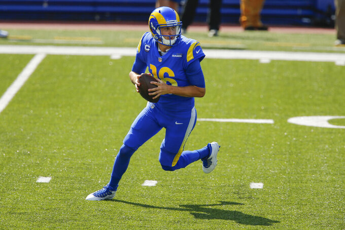 Los Angeles Rams quarterback Jared Goff (16) looks to pass during the first half of an NFL football game against the Buffalo Bills Sunday, Sept. 27, 2020, in Orchard Park, N.Y. (AP Photo/John Munson)
