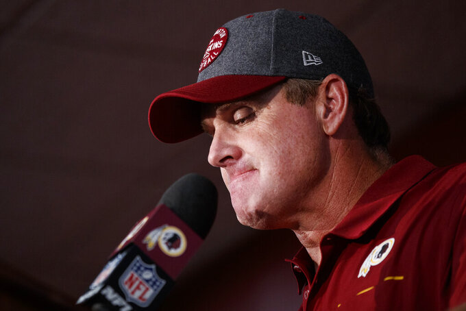 "Washington Redskins head coach Jay Gruden pauses while speaking during a news conference after an NFL football game against the Dallas Cowboys, Sunday, Sept. 15, 2019, in Landover, Md. The Redskins face injury and defensive questions after falling to 0-2 with a loss to the Dallas Cowboys and the Chicago Bears coming to town for ""Monday Night Football.""  (AP Photo/Alex Brandon)"