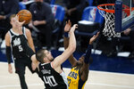 Los Angeles Clippers' Ivica Zubac (40) dunks over Indiana Pacers' Caris LeVert (22) during the first half of an NBA basketball game, Tuesday, April 13, 2021, in Indianapolis. (AP Photo/Darron Cummings)