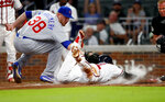 Atlanta Braves' Johan Camargo (17) is tagged out by Chicago Cubs relief pitcher Mike Montgomery (38) as he tries to score on a wild pitch in the fifth inning of a baseball game Tuesday, May 15, 2018, in Atlanta. (AP Photo/John Bazemore)