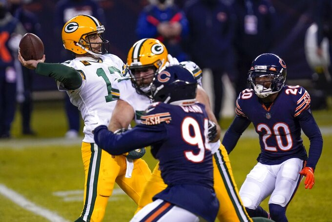 Green Bay Packers' Aaron Rodgers throws a pass during the first half of an NFL football game against the Chicago Bears Sunday, Jan. 3, 2021, in Chicago. (AP Photo/Charles Rex Arbogast)