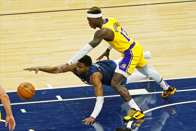 Minnesota Timberwolves' Malik Beasley, left, dives as he and Los Angeles Lakers' Dennis Schroder (17) chase the loose ball in the first half of an NBA basketball game, Tuesday, Feb. 16, 2021, in Minneapolis. (AP Photo/Jim Mone)