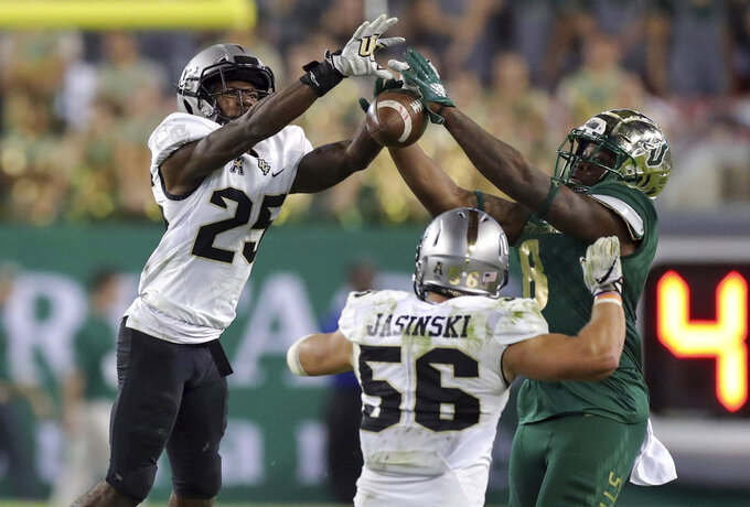 Central Florida's Kyle Gibson (25) breaks up a pass intended for South Florida's Tyre McCants during the second half of an NCAA college football game Friday, Nov. 23, 2018, in Tampa, Fla. (AP Photo/Mike Carlson)