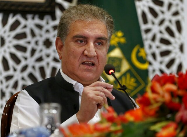 Pakistan Foreign Minister Shah Mahmood Qureshi speaks to reporters at the Foreign Ministry in Islamabad, Pakistan, Monday, Aug. 24, 2020. Qureshi told reporters he would meet with a Taliban delegation on Tuesday. Islamabad's role was only to