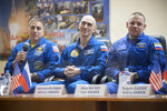 In this handout photo released by Roscosmos U.S. astronaut Chris Cassidy, left, Russian cosmonauts Anatoly Ivanishin, centre, and Ivan Vagner, members of the main crew to the International Space Station (ISS), attend a news conference at the Baikonur Cosmodrome, Kazakhstan, Wednesday, April 8, 2020. The new Soyuz mission to the International Space Station is scheduled on Thursday, April 9. (Roscosmos Space Agency Press Service via AP)