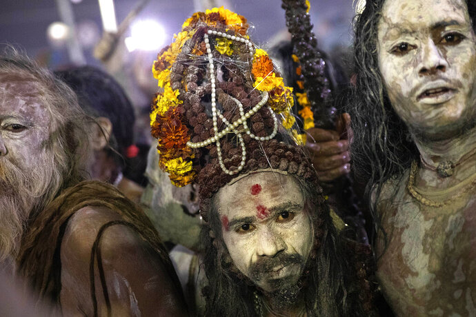 Indian Sadhus, or Hindu holy men, covered in ash walk before taking a ritualistic dip on auspicious Makar Sankranti day during the Kumbh Mela, or pitcher festival in Prayagraj, Uttar Pradesh state, India, Tuesday, Jan.15, 2019. The Kumbh Mela is a series of ritual baths by Hindu holy men, and other pilgrims at the confluence of three sacred rivers  the Yamuna, the Ganges and the mythical Saraswati  that dates back to at least medieval times. The city's Mughal-era name Allahabad was recently changed to Prayagraj. (AP Photo/Bernat Armangue)