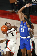 Georgia's Sahvir Wheeler (2) shoots while being defended by North Georgia forward Frank Champion (23) during an NCAA college basketball exhibition game in Athens, Ga., Wednesday, Dec. 2, 2020. (Joshua L. Jones/Athens Banner-Herald via AP)