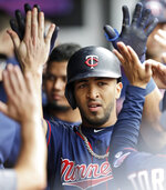 Minnesota Twins' Eddie Rosario is congratulated by teammates after Rosario hit a solo home run in the seventh inning of a baseball game against the Cleveland Indians, Sunday, Sept. 15, 2019, in Cleveland. (AP Photo/Tony Dejak)