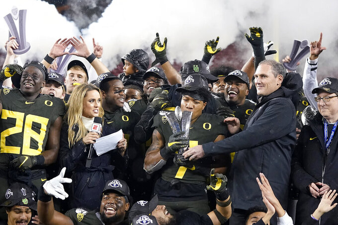 Oregon running back CJ Verdell (7) and teammates celebrate after Oregon defeated Utah 37-15 in an NCAA college football game for the Pac-12 Conference championship in Santa Clara, Calif., Friday, Dec. 6, 2018. (AP Photo/Tony Avelar)