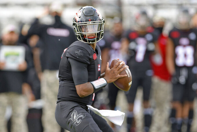 Louisiana-Lafayette quarterback Levi Lewis (1) steps back to throw during an NCAA college football game against South Alabama in Lafayette, La., Saturday, Nov. 14, 2020. (AP Photo/Matthew Hinton)