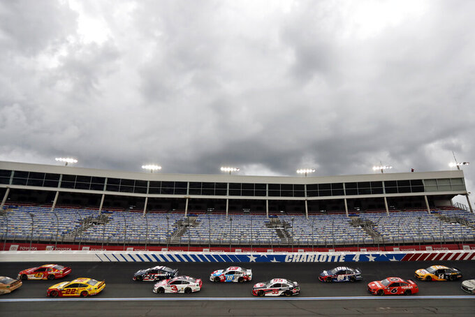 Dark clouds fill the sky during the NASCAR Cup Series auto race at Charlotte Motor Speedway Sunday, May 24, 2020, in Concord, N.C. (AP Photo/Gerry Broome)