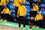 Michigan head coach Juwan Howard watches from the bench during the first half of a second-round game against LSU in the NCAA men's college basketball tournament at Lucas Oil Stadium Monday, March 22, 2021, in Indianapolis. (AP Photo/Darron Cummings)