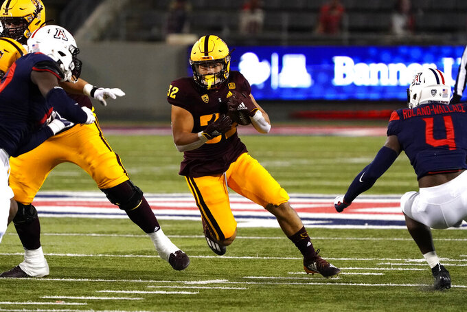 Arizona State running back Jackson He (32) runs the football in the second half during an NCAA college football game against Arizona, Friday, Dec. 11, 2020, in Tucson, Ariz. (AP Photo/Rick Scuteri)