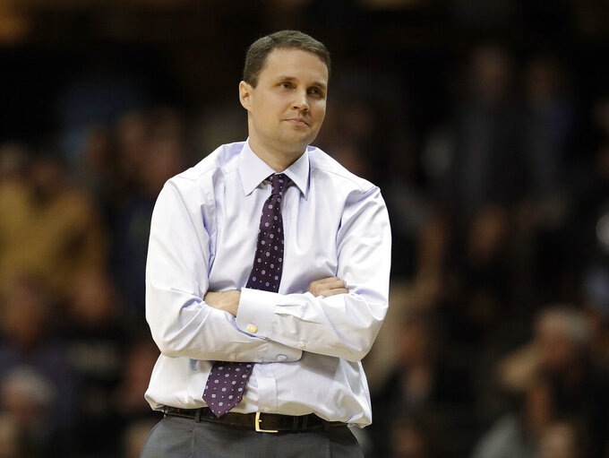 "FILE - In this Jan. 20, 2018, file photo, LSU coach Will Wade watches from the sideline during the second half of the team's NCAA college basketball game against Vanderbilt in Nashville, Tenn. Wade acknowledged Tuesday, May 28, 2019, making ""some mistakes"" when he refused to speak with school officials in March 2019 regarding a leaked FBI wiretap transcript that raised questions about whether he committed recruiting violations. (AP Photo/Mark Humphrey, File)"